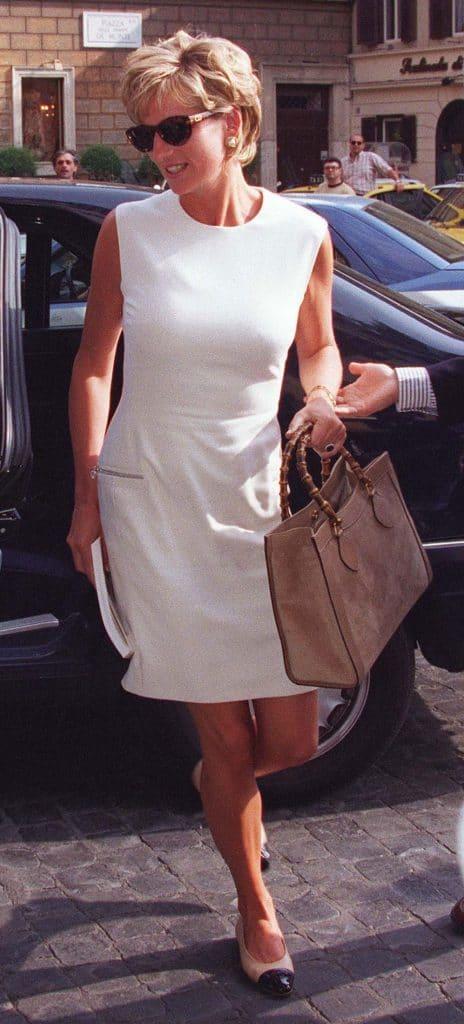 Princess Diana holding a beautiful Gucci bag.